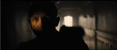 "Bond (Daniel Craig) cautiously enters the room in ""Skyfall."""